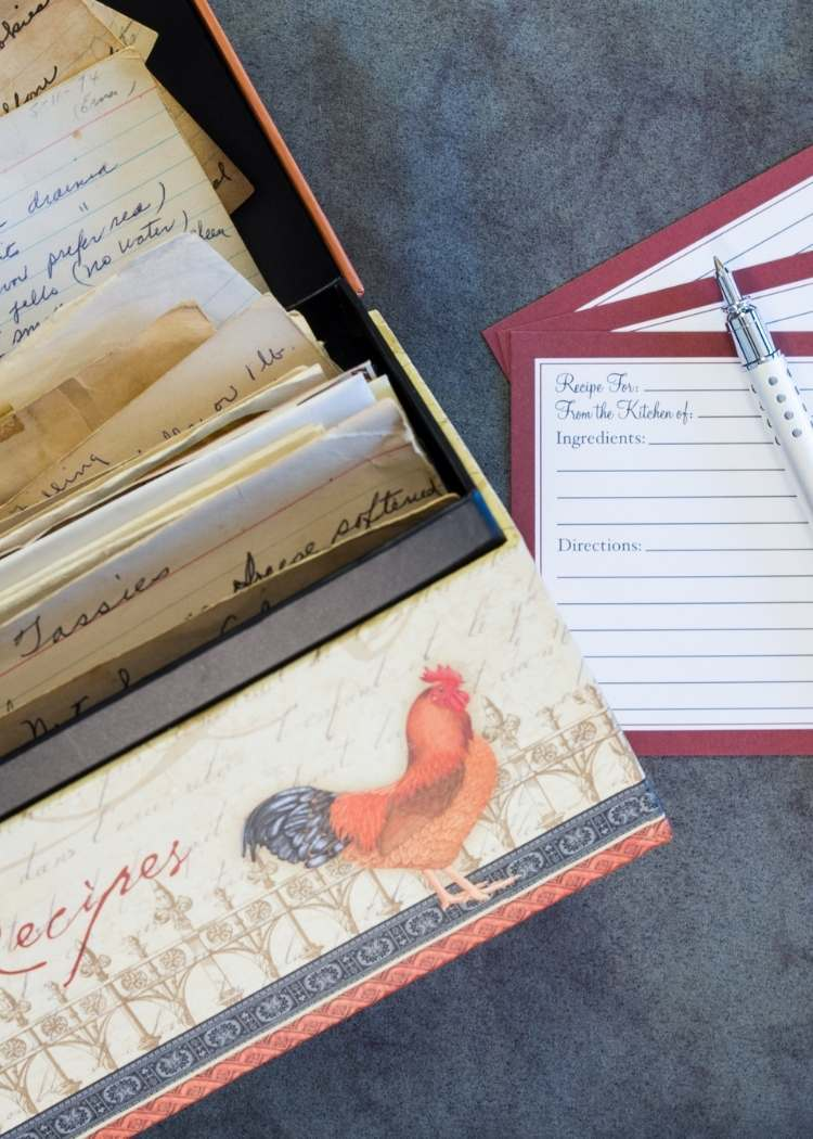 recipe box with recipe cards and pen