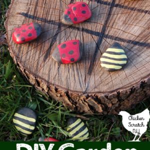 Earth day for families outdoor craft and game of tic tac toe made from a cut sti=ump an rocks painted as lady bugs and bubble bees