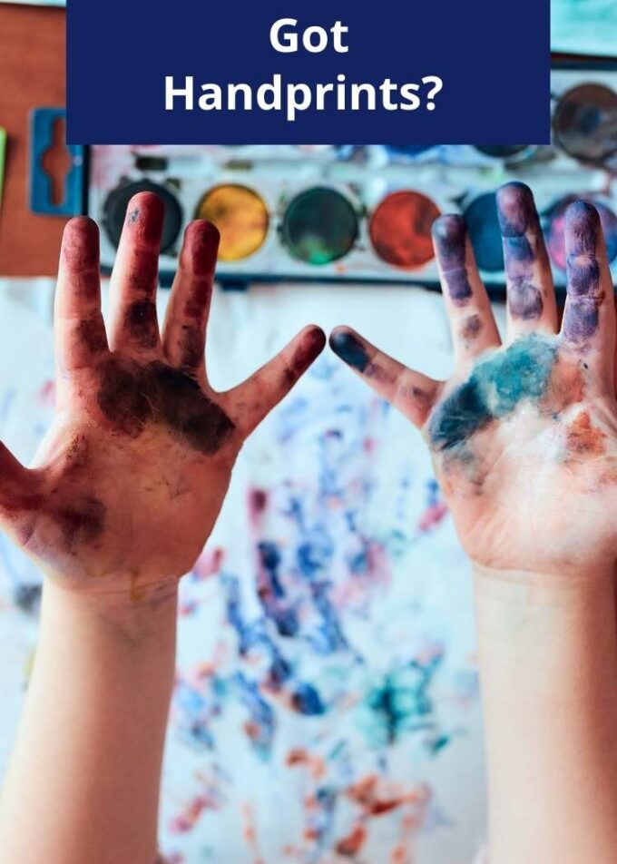 Childs hands covered in paint with the caption Got Handprints