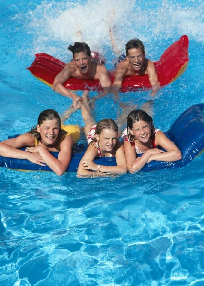 kids in a swimming pool on a floatie