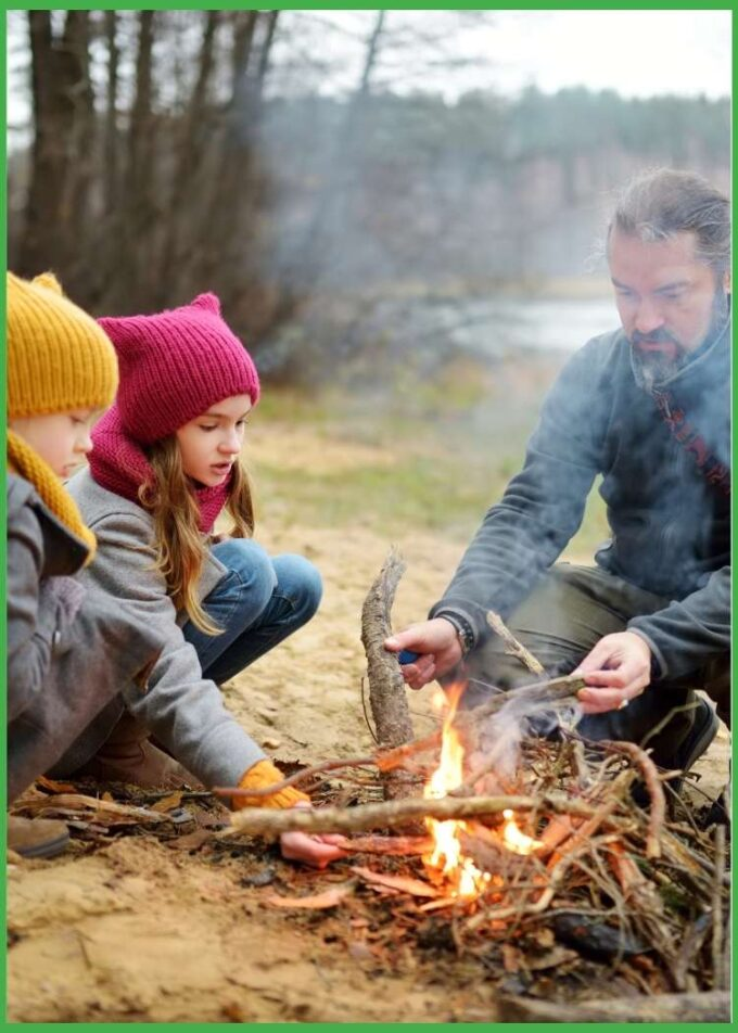 Dad and two children sitting at a campfire, happy Father's Day husband