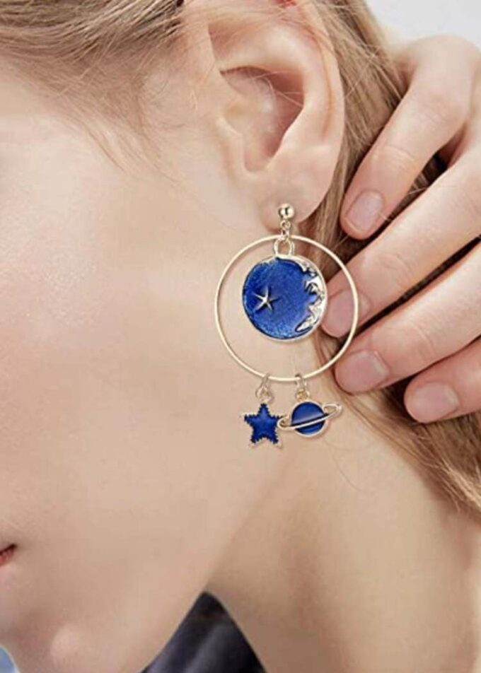 Close up of ear with solar stem earrings